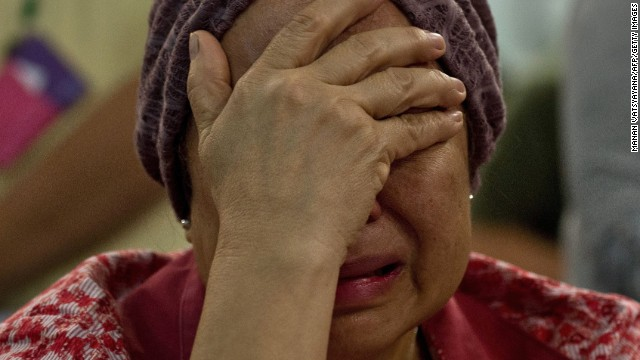 Akmar Binti Mohd Noor, whose sister was onboard Flight 17, cries outside the family holding area at Kuala Lumpur International Airport on July 18.