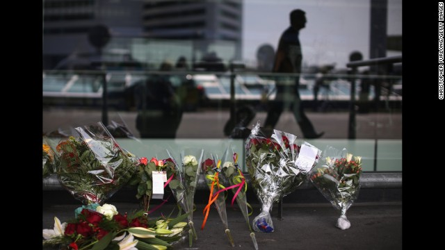Floral tributes adorn the entrance to Schiphol Airport in Amsterdam. in memory of the victims.