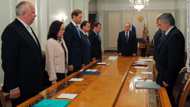 Russian President Vladimir Putin, center, and members of his government observe a moment of silence on July 17.