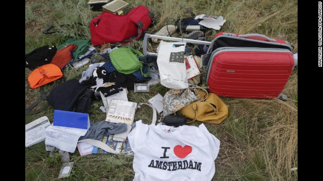 Books, bags, a tourist T-shirt. Ukraine's government said it had received information of looting of valuables and money, and urged relatives to cancel the victims' credit cards. But a CNN crew at the scene on July 19 said it did not see any signs of looting.