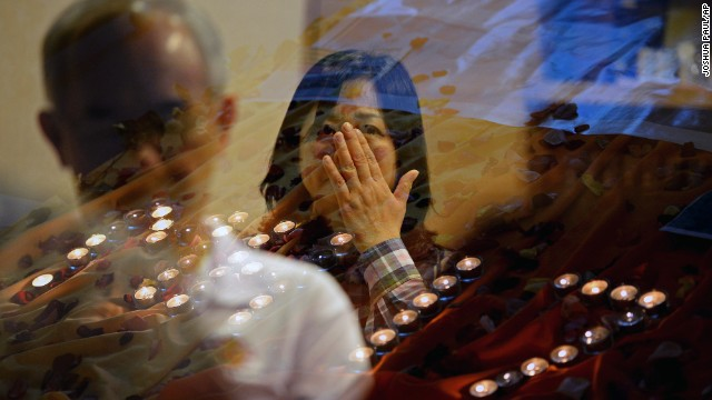 People pray for the victims of <a href='http://www.cnn.com/specials/world/mh17-specials-page/index.html' target='_blank'>Malaysia Airlines Flight 17</a> at a church outside Kuala Lumpur on July 18.