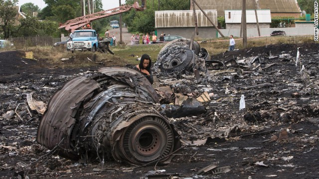 A woman walks through the debris field on July 18.