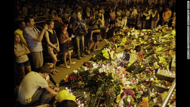 People leave flowers for the victims at the Dutch Embassy in Kiev.