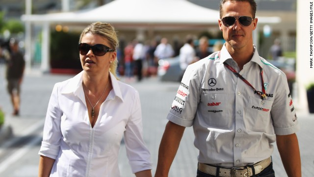 Corinna Schumacher, seen here with husband Michael in 2011, has striven to retain the family's privacy. She published a note of thanks to fans in the official program of the 2014 German Grand Prix.
