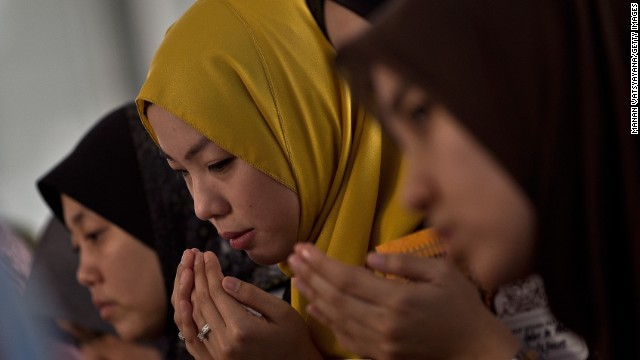 Friends of Nur Shazana Mohamed, a crew member aboard Malaysia Airlines Flight 17, take part in a special remembrance prayer at a mosque in Putrajaya, Malaysia, on July 19.