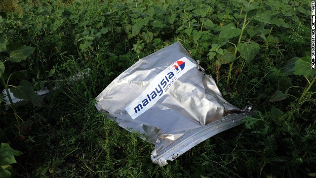 An envelope bearing the Malaysia Airlines logo is seen at the crash site on July 19.