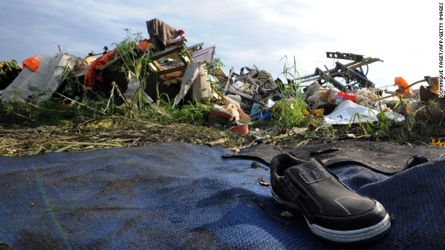 A single shoe is seen among the debris and wreckage on July 19. Concern is growing that the site has not been sealed off as it should have been and that vital evidence is being tampered with.