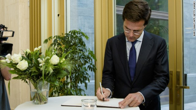 "Dutch Prime Minister Mark Rutte signs a condolence register at the Ministry of Safety and Justice in The Hague, the Netherlands, on Friday, July 18, in memory of the victims of Malaysia Airlines Flight 17. ""I want to see results in the form of unimpeded access and rapid recovery,"" Rutte said in a press briefing. ""This is now priority number one."""