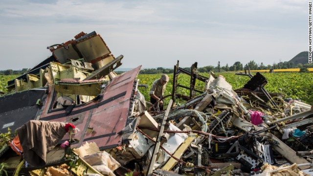 A man looks through the debris at the crash site on July 19.