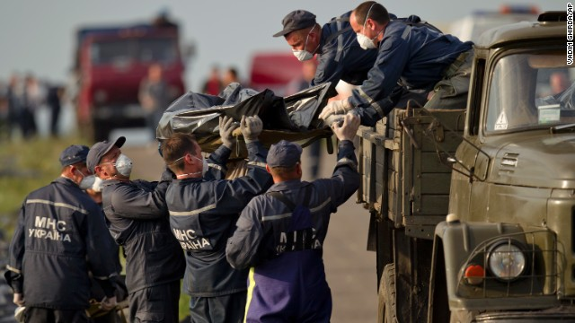 Emergency workers load the body of a victim onto a truck at the crash site on Saturday, July 19.