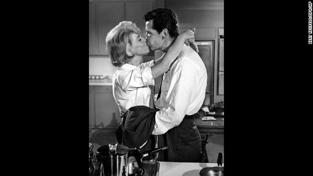 "Doris Day kisses Garner in a scene from the 1963 film ""The Thrill Of It All."""