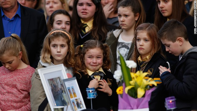 Mourners attend a memorial service on Sunday, July 20, in Eynesbury, Australia, for a family of five killed in the Flight 17 disaster.
