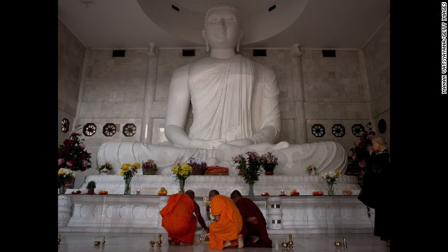 Buddhist monks in the Malaysian capital light candles during a special prayer for the victims on July 20.