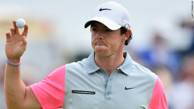 Rory McIlroy acknowledges the gallery after holing a crucial birdie putt on the ninth on the way to his British Open triumph.