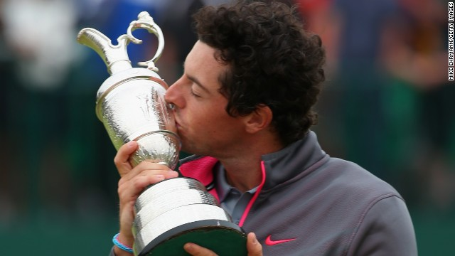 Rory McIlroy gets up close and personal with The Claret Jug as he savors his maiden British Open triumph.