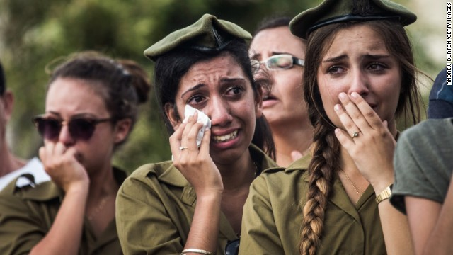Israeli soldiers weep at the grave of Israeli Sgt. Adar Barsano during his funeral on Sunday, July 20, in Nahariya, Israel.