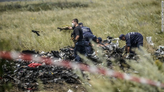 Ukrainian State Emergency Service employees sort through debris on July 20 as they work to locate the deceased.