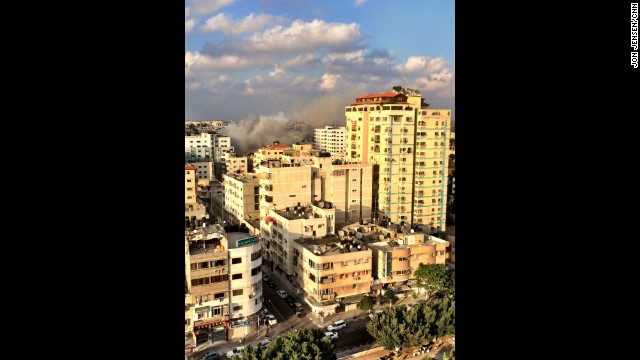 GAZA CITY: A smoke plume rises over Gaza following an Israeli airstrike. Photo by CNN's Jon Jensen, July 20. Fierce fighting between Israeli troops and Hamas militants continued near Gaza City on Monday as the death toll from the conflict rose above 500. <a href='http://www.cnn.com/2014/07/21/world/meast/mideast-crisis/index.html?hpt=hp_inthenews'>FULL STORY AT CNN.COM</a>. Follow Jon (<a href='http://instagram.com/jonjensencnn' target='_blank'>@jonjensencnn</a>) and other CNNers along on Instagram at <a href='http://instagram.com/cnn' target='_blank'>instagram.com/cnn</a>.
