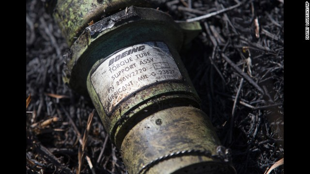 A piece of the Boeing 777 lies in the grass in eastern Ukraine's Donetsk region on July 21.