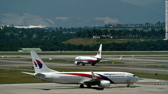 A Malaysia Airlines plane taxis on the runway at the Kuala Lumpur International Airport on July 20.