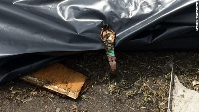 "Cuomo shared this image, saying ""rumors of looting here are rampant. It's telling that the only watch we see is a broken one placed on a body bag."""