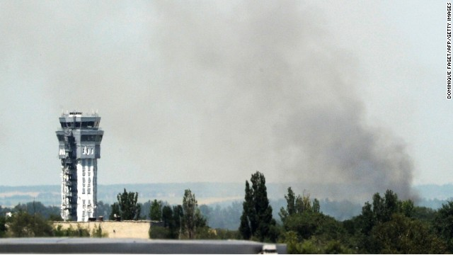 Smoke rises near the airport traffic control tower in Donetsk, eastern Ukraine on Monday.