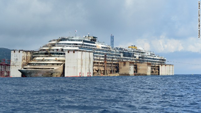 Air tanks are used to resurface the Costa Concordia on Monday, July 21, in Giglio, Italy. The cruise liner will soon be towed away from the island, where it ran aground and sank two and a half years ago.