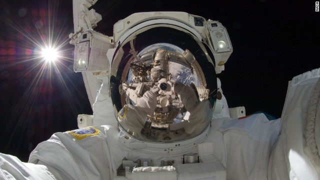 <a href='http://spaceflight.nasa.gov/gallery/images/station/crew-32/html/iss032e025258.html' target='_blank'>Japan Aerospace Exploration Agency astronaut Aki Hoshide</a> took this breathtaking selfie during Expedition 32 on September 5, 2012. Using a digital stills camera while on the third spacewalk of the voyage, Hoshide reflects the Earth in his helmet visor with the sun brilliantly visible in the top left corner.