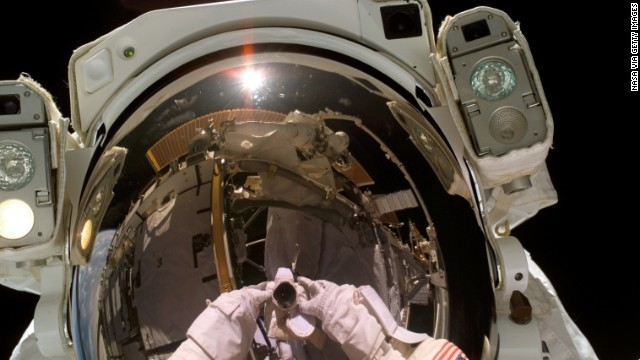Astronaut Heidemarie M. Stefanyshyn-Piper, STS-115 mission specialist, takes a self-portrait during a spacewalk on September 12, 2006 that marked the continuation of construction on the ISS.
