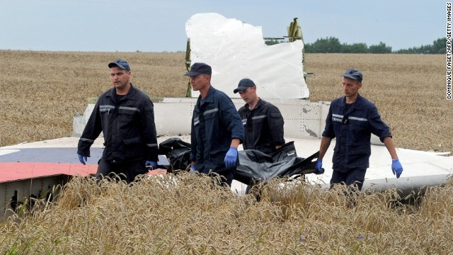 A body is removed from the site of the downed MH17 aircraft in eastern Ukraine.