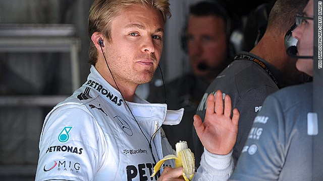 Formula One drivers cannot survive on bananas alone -- but they do make a handy garage snack, as Mercedes driver Nico Rosberg shows.