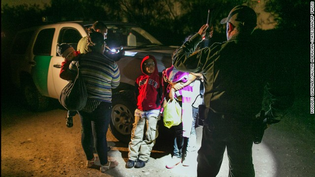 Mothers and children from Honduras prepare to get into a customs agent's truck after crossing the Rio Grande into Texas.