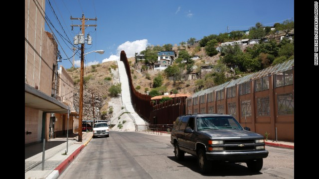 A steel border fence separates Nogales, Arizona, from its sister city in Sonora, Mexico. Nogales is Arizona's largest international border town and an entry point for goods and people from Mexico.