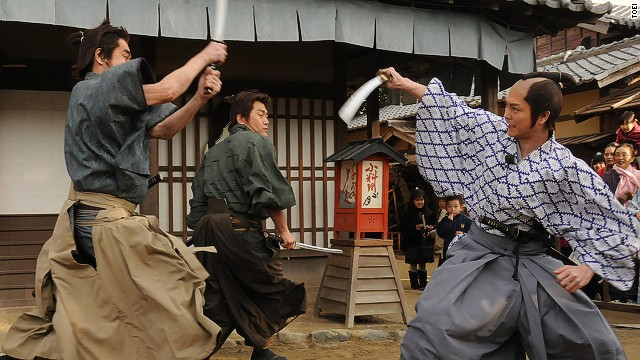 During Toei Kyoto Studio Park's samurai sword fighting demonstrations, audience volunteers are invited to learn a few moves from the actors.