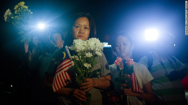 Families of crew members aboard Malaysia Airlines Flight 17 gather for a vigil Tuesday, July 22, in Kuala Lumpur, Malaysia. All 298 people aboard the passenger plane died when it was shot down Thursday, July 17, in a rebel-controlled part of eastern Ukraine.