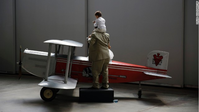 Andy Pharo, 2, and his father, Mark Pharo, enjoy the museum's Western Air Express Douglas M-2 model airplane.