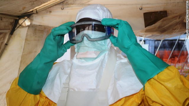 A member of Doctors Without Borders puts on protective gear at the isolation ward of the Donka Hospital in Conakry, Guinea, on Saturday, June 28.