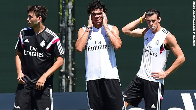 Gareth Bale (R) and Pepe (center) tune up in Los Angeles ahead of Real's opening game. The Spanish giants, who won the European Champions League last season, face Italian side Inter in their first match, hoping to attract a legion of new fans.