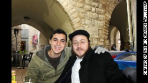 Sean Carmeli poses with Rabbi Asher Hecht in Jerusalem in 2012. His funeral was Monday night in the Israeli city of Haifa.