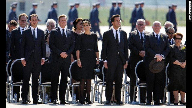 Dutch Queen Maxima, center, stands between King Willem-Alexander and Prime Minister Mark Rutte as a minute of silence is observed in Eindhoven on July 23.