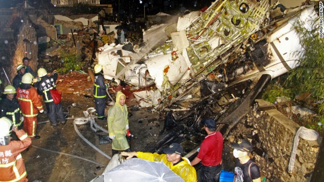 Rescue workers at the wreckage of Flight GE222, a twin-engine turboprop plane.