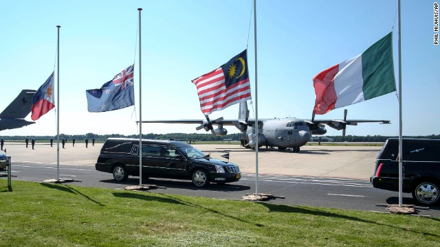 Flags fly at half-staff as hearses pass by in Eindhoven on July 23.