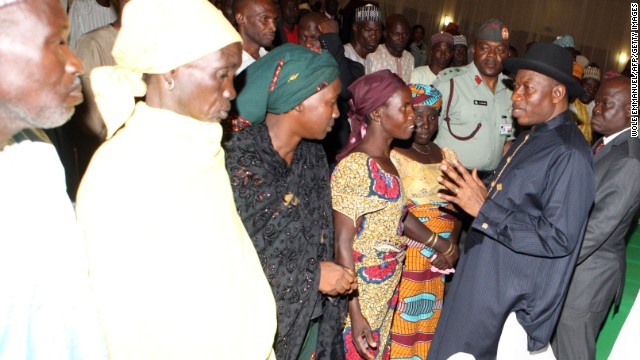 President Jonathan meets Chibok schoolgirls who escaped Islamist captors, and relatives of the hostages, in Abuja on July 22.