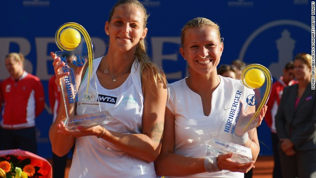 After struggling with her health in recent years, the Dutch player has had more success in doubles, winning six titles on the WTA Tour. Here she celebrates with Karolina Pliskova (left) after their success in Nuremberg in May.