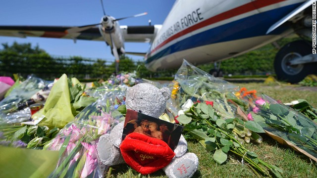 Eindhoven military air base, July 23, 2014: Flowers and a teddy bear are placed in front of a plane before a ceremony marking the return of the first bodies of passengers on board Malaysia Airlines Flight 17. The bodies will be taken to a military barracks in the city of Hilversum, where forensic experts will begin the task of identifying and returning them to relatives.