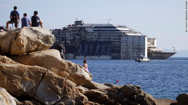 JULY 23 - GIGLIO, ITALY: <a href='http://cnn.com/2014/07/23/world/europe/costa-concordia-leaves-behind/index.html'>The wreck of the Costa Concordia cruise ship </a>is towed away from the tiny Tuscan island of Giglio. More than two years after it crashed into a reef and capsized, the ship has begun its final journey to the Italian port of Genoa, where it will be scrapped.