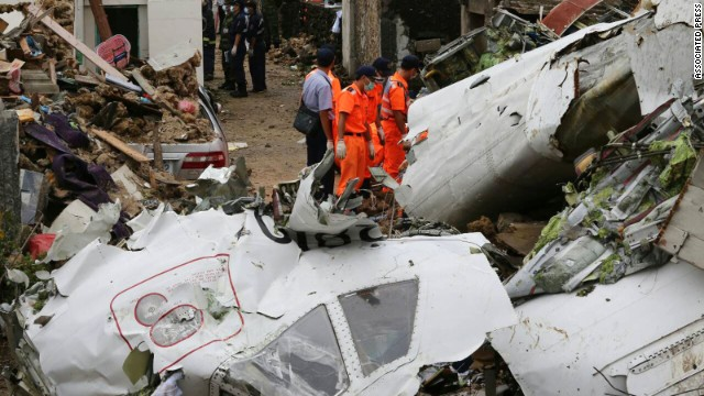 Rescue workers survey the wreckage on the Taiwanese island of Penghu on July 24.