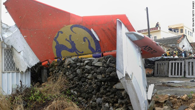 The tail section of planes lies amid rubble where it landed.