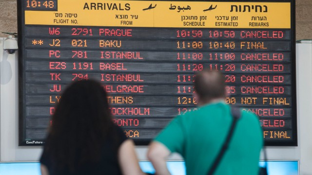 A departure flight board displays various canceled and delayed flights in Ben Gurion International airport.