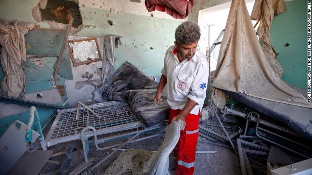 A worker cleans up at Shuhada al-Aqsa Hospital in Gaza after it was shelled on July 21.